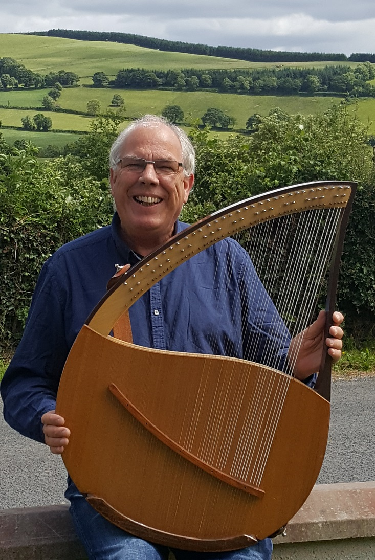John laughing with his lyre