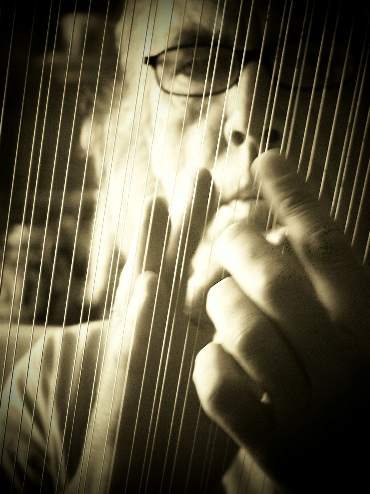 John through the strings of his lyre